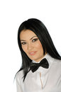 Beautiful brunette wearing a black tie bow against white background Stock Photo
