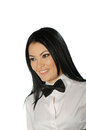 Beautiful brunette wearing a black tie bow against white background Royalty Free Stock Photography