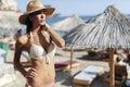 Beautiful brunette wearing hat on beach Royalty Free Stock Photo