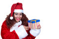 Beautiful brunette wearing santa claus with gift Royalty Free Stock Image