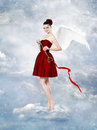 Beautiful brunette woman as cupid angel with key to heart Royalty Free Stock Image
