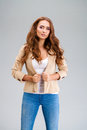 Beautiful brunette woman in a beige jacket Royalty Free Stock Photo