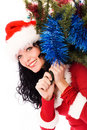 Beautiful brunette woman carrying a Christmas tree Royalty Free Stock Photos