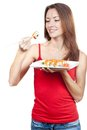 Beautiful brunette woman eating sushi this image has attached release Royalty Free Stock Photo