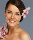 Beautiful brunette woman with flowers Royalty Free Stock Photo