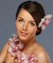 Beautiful brunette woman with flowers Stock Image