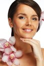 Beautiful brunette woman with flowers Stock Photography