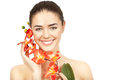 Beautiful brunette woman holding branch of orchid this image has attached release Royalty Free Stock Images