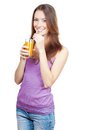 Beautiful brunette woman holding glass of juice healthy lifestyle Stock Photo