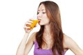 Beautiful brunette woman holding glass of juice healthy lifestyle Royalty Free Stock Image