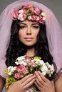 Beautiful Brunette Woman holding Summer Flowers