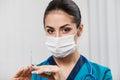 Beautiful brunette woman medical worker young nurse holding syringe Stock Image