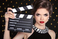 Beautiful brunette woman model holding film clap board cinema Royalty Free Stock Photo