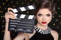 Beautiful brunette woman model holding film clap board cinema Royalty Free Stock Photo
