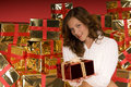 Beautiful brunette woman offering a Christmas gift Royalty Free Stock Photo
