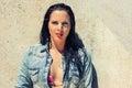 Beautiful brunette woman wet hair sunlight outdoor portrait makeup bikini Royalty Free Stock Images