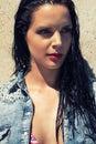 Beautiful brunette woman wet hair sunlight outdoor portrait makeup bikini Stock Photography