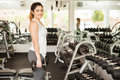 Beautiful brunette working out in a gym Royalty Free Stock Photo