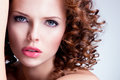 Beautiful brunette young woman with bright make up portrait of closeup face curly hairstyle Stock Images