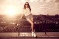 Beautiful brunette young woman wearing sunglasses, shorts, white Royalty Free Stock Photo