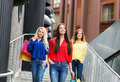 Beautiful brunettes and blond with shopping bags going down the outside stairs in the city center Stock Photography