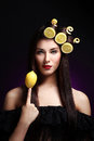 Beautiful brunnete with lemons in her hairstyle Royalty Free Stock Image