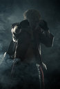 Beautiful brutal hero fighting isolated on black background Royalty Free Stock Images