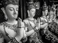 Beautiful buddhist sculpture hands clasped in prayer, detail of buddhist figures carved in Wat Sanpayangluang at Lamphun, Thailand Royalty Free Stock Photo