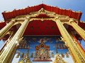 Beautiful Buddhist temple soars into blue sky Royalty Free Stock Photo