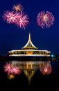 Beautiful building with fireworks reflex on the lagoon against blue sky background in public park suanluang rama thailand Royalty Free Stock Photo
