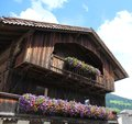 Beautiful building with flowers in San Candido Royalty Free Stock Photo