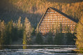 Beautiful building in the form of a triangle on the lake around forest Royalty Free Stock Images