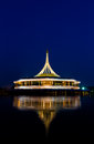 Beautiful building with reflex on the lagoon againt blue sky background in public park suanluang rama thailand Royalty Free Stock Image