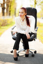 Beautiful business lady sitting on the office chair shot is taken outdoor young Stock Images