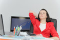 Beautiful business woman dreaming while working on computer at h Royalty Free Stock Photo