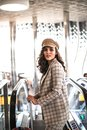 stock image of  Beautiful business woman on escalator in airport.
