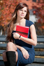 Beautiful business woman hoding diary at park Stock Image