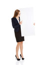 Beautiful business woman holding empty board copy space isolated on white Stock Photography