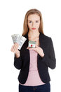 Beautiful business woman holding hpuse and dollars money. Royalty Free Stock Photo