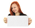 Beautiful business woman holding up a blank banner Royalty Free Stock Images