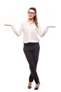 Beautiful business woman making a scale with her arms wide open. Royalty Free Stock Photo