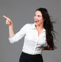 Beautiful business woman pointing at copyspace Royalty Free Stock Photo