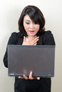 Beautiful business woman scared with her laptop screen Stock Photos