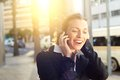 Beautiful business woman smiling on mobile phone outdoors Royalty Free Stock Photo