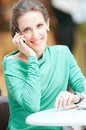 Beautiful business woman talking on cell phone Royalty Free Stock Photography