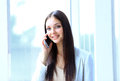 Beautiful business woman talking on cell phone while looking at copyspace Royalty Free Stock Image