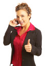 Beautiful business woman talking on cellphone giving thumbs up isolated white Royalty Free Stock Photos