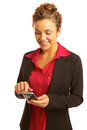 Beautiful business woman text messaging holding cellphone Stock Photography