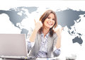 Beautiful business woman with thumbs up in office Royalty Free Stock Photo
