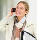 Beautiful business woman using her cell phone and Stock Image